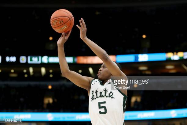 Cassius Winston of the Michigan State Spartans attempts a shot in the first half against the Michigan Wolverines during the championship game of the...