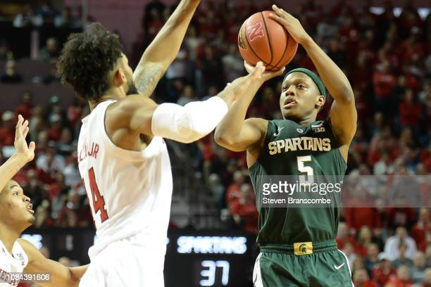 Cassius Winston of the Michigan State Spartans attempts a shot over Isaac Copeland Jr #14 of the Nebraska Cornhuskers at Pinnacle Bank Arena on...