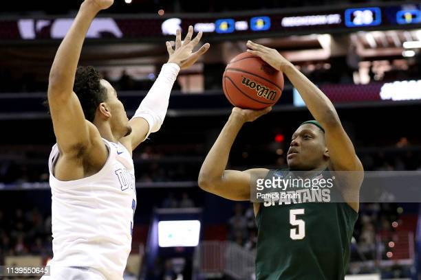 Cassius Winston of the Michigan State Spartans attempts a shot against Tre Jones of the Duke Blue Devils during the first half in the East Regional...