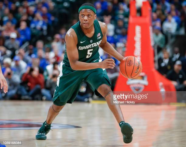 Cassius Winston of the Michigan State Spartans brings the ball up court during the game against the Kansas Jayhawks at Bankers Life Fieldhouse on...