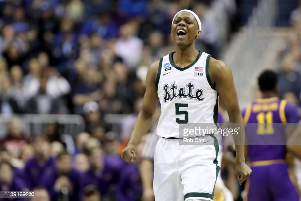 Cassius Winston of the Michigan State Spartans celebrates a basket against the LSU Tigers during the first half in the East Regional game of the 2019...