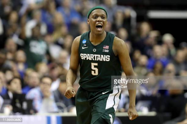 Cassius Winston of the Michigan State Spartans celebrates a basket against the Duke Blue Devils during the first half in the East Regional game of...