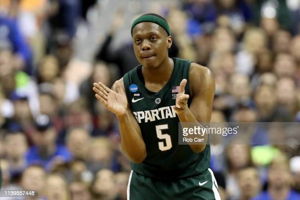 Cassius Winston of the Michigan State Spartans celebrates a basket against the Duke Blue Devils during the second half in the East Regional game of...