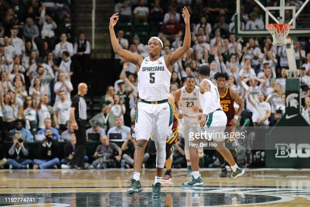 Cassius Winston of the Michigan State Spartans celebrates after making a threepoint shot during the second half of the game against the Minnesota...