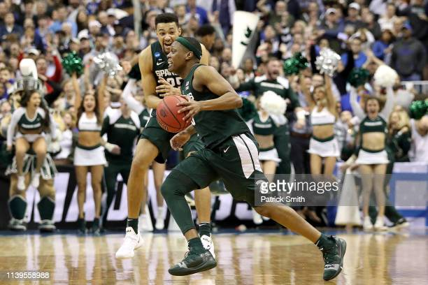 Cassius Winston of the Michigan State Spartans celebrates after his teams 68-67 win over the Duke Blue Devils in the East Regional game of the 2019...
