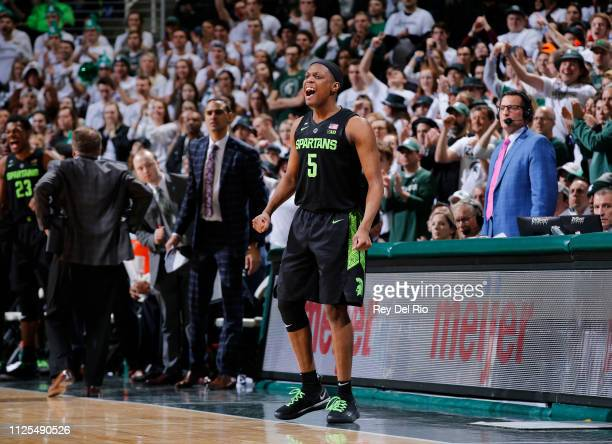 Cassius Winston of the Michigan State Spartans celebrates from the sidelines during a game against the Ohio State Buckeyes in the second half at...