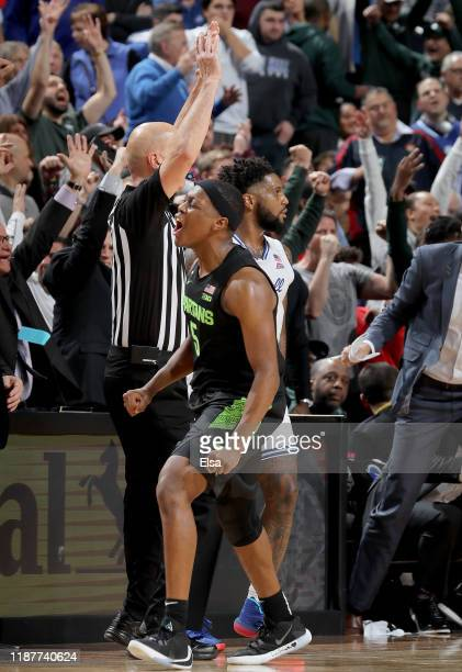 Cassius Winston of the Michigan State Spartans celebrates his three point shot in the second half against the Seton Hall Pirates at Prudential Center...
