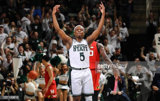 Cassius Winston of the Michigan State Spartans celebrates making a threepoint basket in the second half of the game against the Maryland Terrapins at...