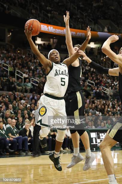 Cassius Winston of the Michigan State Spartans drives to the basket past Evan Boudreaux of the Purdue Boilermakers during the first half at Breslin...