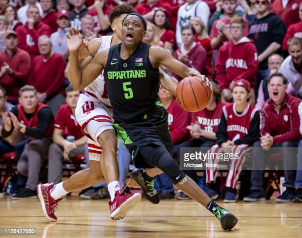Cassius Winston of the Michigan State Spartans drives to the basket around Rob Phinisee of the Indiana Hoosiers at Assembly Hall on March 2 2019 in...