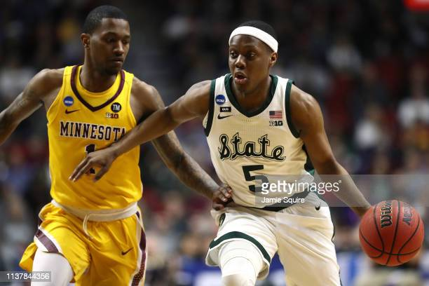 Cassius Winston of the Michigan State Spartans drives to the basket against Dupree McBrayer of the Minnesota Golden Gophers during the first half in...