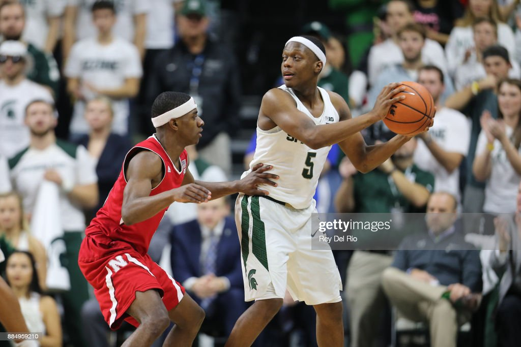 Cassius Winston #5 of the Michigan State Spartans handles the ball against Glynn Watson Jr. #5 of the Nebraska Cornhuskers at Breslin Center on December 3, 2017 in East Lansing, Michigan.