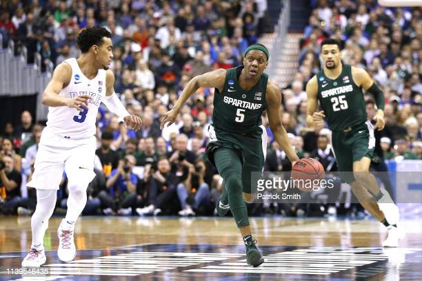 Cassius Winston of the Michigan State Spartans is defended by Tre Jones of the Duke Blue Devils during the first half in the East Regional game of...