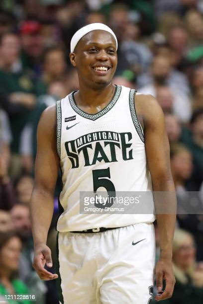 Cassius Winston of the Michigan State Spartans looks on while playing the Ohio State Buckeyes at the Breslin Center on March 08 2020 in East Lansing...