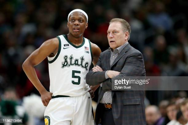 Cassius Winston of the Michigan State Spartans meets with head coach Tom Izzo in the first half against the Wisconsin Badgers during the semifinals...