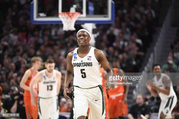 Cassius Winston of the Michigan State Spartans runs down the court while playing the Syracuse Orange in the second round of the 2018 NCAA Men's...