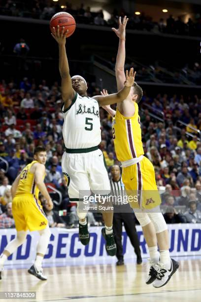 Cassius Winston of the Michigan State Spartans shoots the ball against Michael Hurt of the Minnesota Golden Gophers during the first half in the...