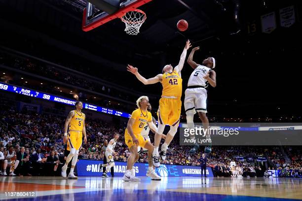 Cassius Winston of the Michigan State Spartans shoots the ball against Michael Hurt of the Minnesota Golden Gophers during the second half in the...