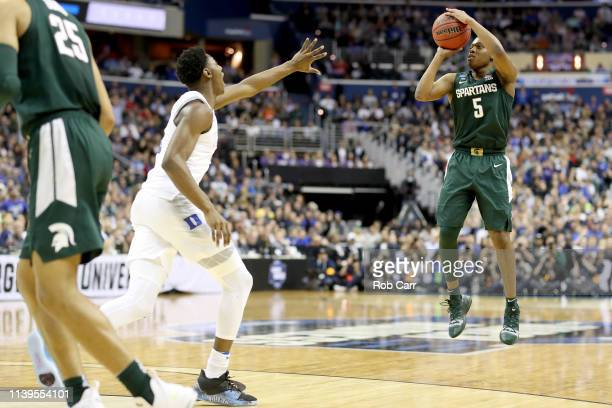 Cassius Winston of the Michigan State Spartans shoots the ball against Javin DeLaurier of the Duke Blue Devils during the second half in the East...