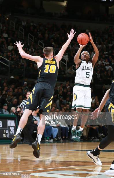 Cassius Winston of the Michigan State Spartans shoots the ball against Joe Wieskamp of the Iowa Hawkeyes in the first half at Breslin Center on...