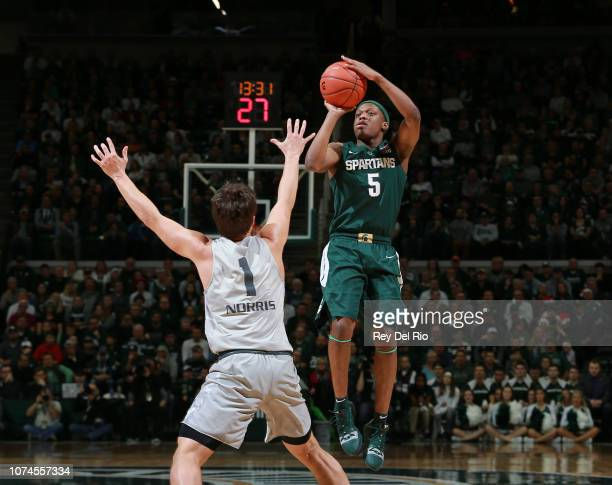 Cassius Winston of the Michigan State Spartans shoots the ball over Braden Norris of the Oakland Golden Grizzlies in the first half at Breslin Center...