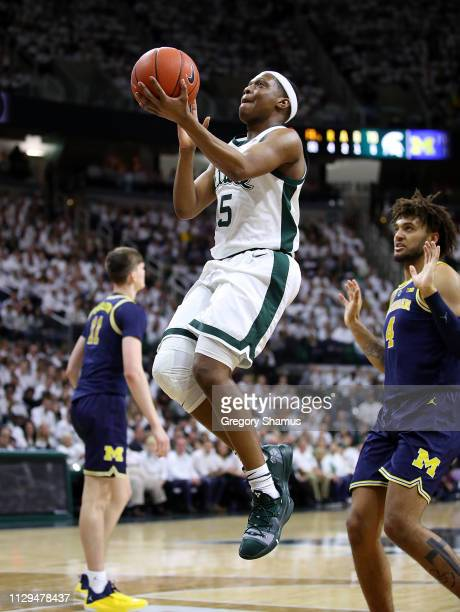 Cassius Winston of the Michigan State Spartans takes a shot against the Michigan Wolverines during the first half at Breslin Center on March 9 2019...