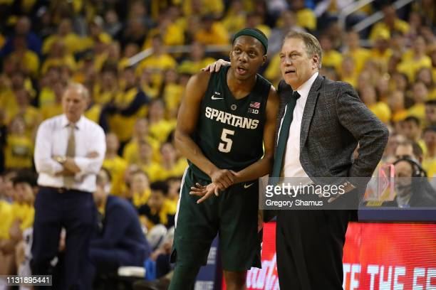 Cassius Winston of the Michigan State Spartans talks with head coach Tom Izzo while playing the Michigan Wolverines at Crisler Arena on February 24...