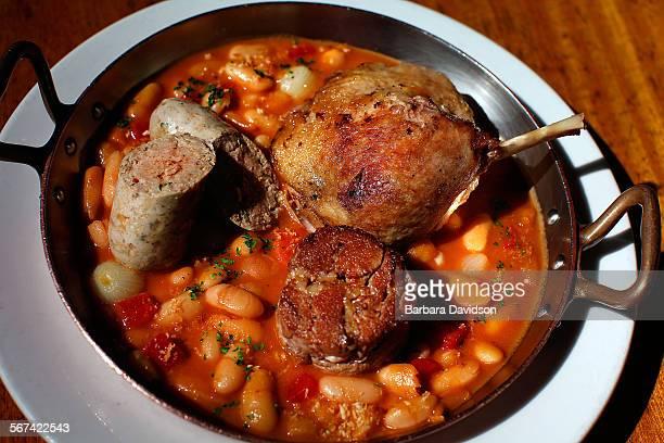LOSANGELES CA 022114 'Cassoulet' Plats PrinciPaux featuring casserole seven hour lamb pork garlic sausage duck leg confit white beans Feb 21 2014...