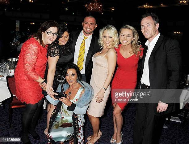 Cast and crew from Strictly Come Dancing including Nancy Dell'Olio Robert Windsor Kristina Rihanoff Ola Jordan and James Jordan pose with the award...
