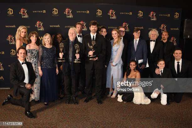 Cast and crew from The Young and the Restless pose with the Daytime Emmy Award for Outstanding Drama Series during the 46th annual Daytime Emmy...