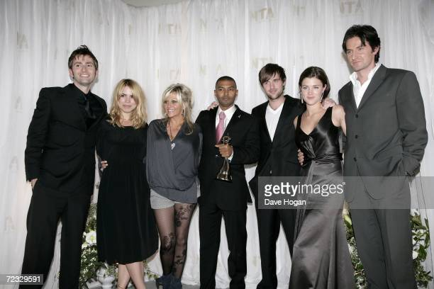 Cast and crew including actors David Tennant Billie Piper Camille Coduri and Noel Clarke pose in the awards room with the award for Most Popular...