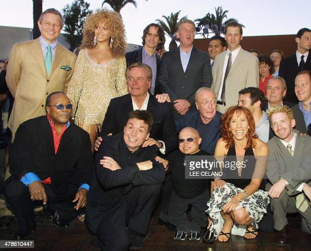 Cast and crew members of Austin Powers in Goldmember pose together before the film's premiere in the Universal City area of Los Angeles 22 July 2002...