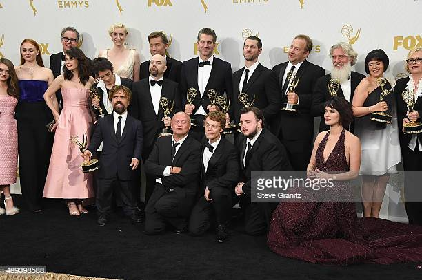 Cast and crew members of the television series 'Game of Thrones' pose with Emmys awards in the press room at the 67th Annual Primetime Emmy Awards at...