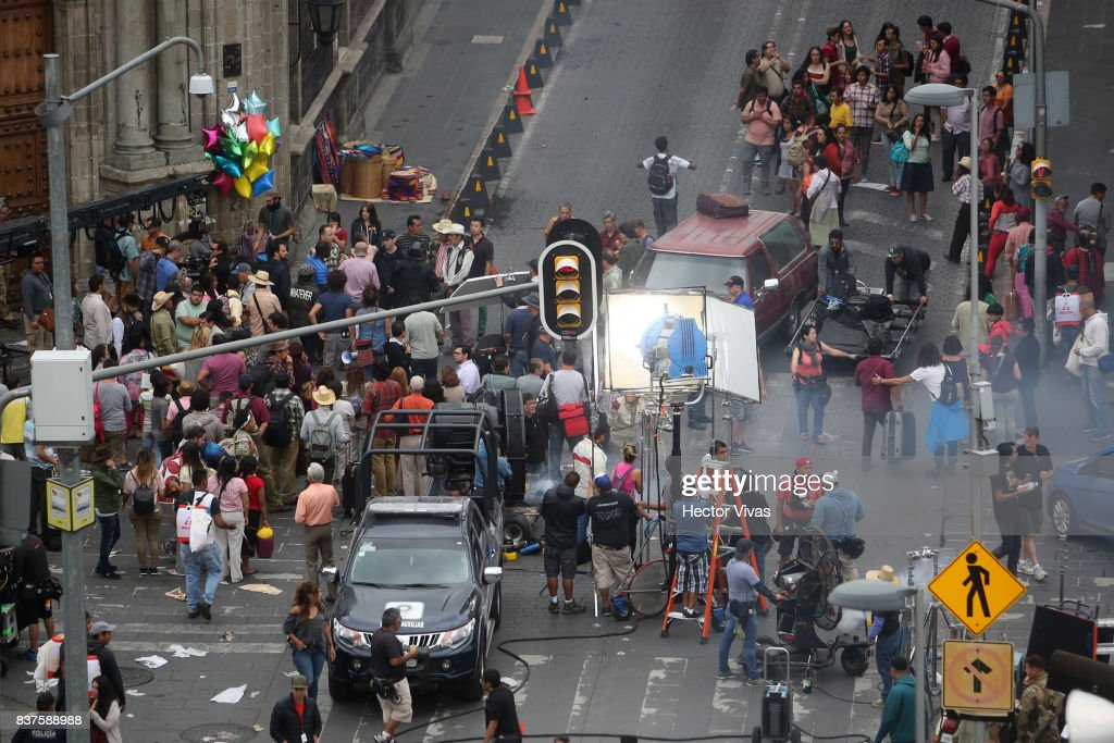Cast and crew members work during the filming of 'Godzilla: King of the Monsters' at Santo Domingo Square on August 22, 2017 in Mexico City, Mexico.