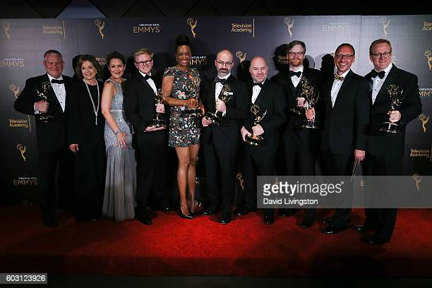 Cast and crew of Archer winner of Outstanding Animated Program pose in the 2016 Creative Arts Emmy Awards Press Room Day 2 at the Microsoft Theater...