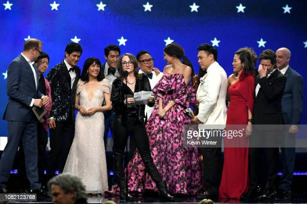 Cast and crew of 'Crazy Rich Asians' accept the Best Comedy award onstage during the 24th annual Critics' Choice Awards at Barker Hangar on January...