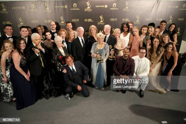 Cast and crew of 'Days of Our Lives' winners of Outstanding Drama Series pose in the press room during the 45th annual Daytime Emmy Awards at...