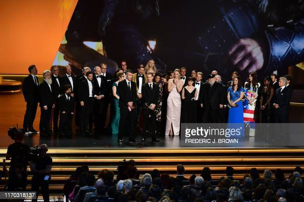 Cast and crew of Game of Thrones accept the Outstanding Drama Series award onstage during the 71st Emmy Awards at the Microsoft Theatre in Los...