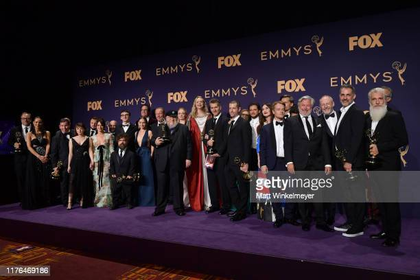 Cast and crew of 'Game of Thrones' pose with awards for Outstanding Drama Series in the press room during the 71st Emmy Awards at Microsoft Theater...