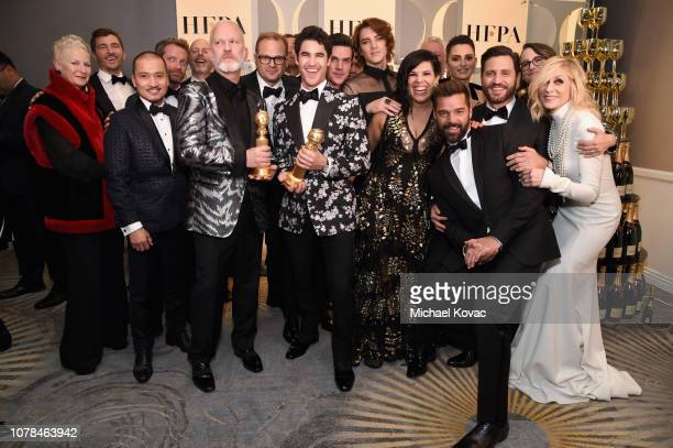 Cast and crew of Inside Look The Assassination of Gianni Versace American Crime Story poses with award at Moet Chandon at The 76th Annual Golden...