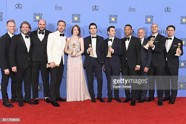 Cast and crew of 'La La Land' winners of Best Motion Picture Musical or Comedy pose in the press room during the 74th Annual Golden Globe Awards at...