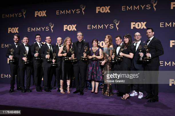 Cast and crew of 'Last Week Tonight with John Oliver' pose with awards for Outstanding Variety Talk Series in the press room during the 71st Emmy...