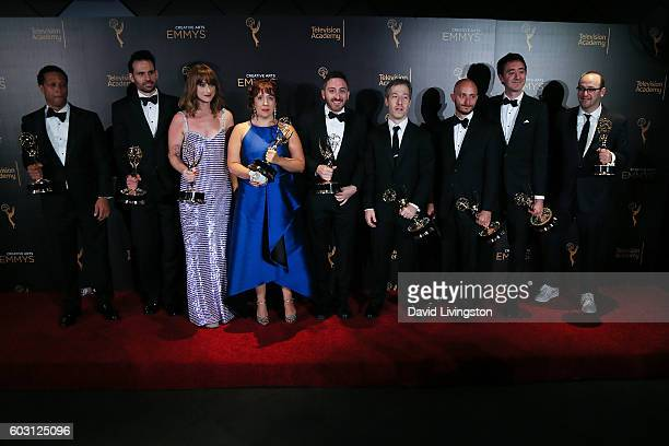 Cast and crew of Last Week Tonight With John Oliver winner of Writing for a Variety Series pose in the 2016 Creative Arts Emmy Awards Press Room Day...
