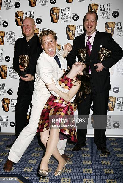 Cast and crew of 'Lazy Town' including actors Julianna Rose Mauriello and Magnus Scheving pose with the International award in the awards room at the...