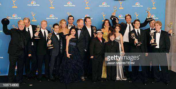 """Cast and crew of """"Modern Family"""", winners of the Outstanding Comedy Series Award pose in the press room at the 62nd Annual Primetime Emmy Awards held..."""