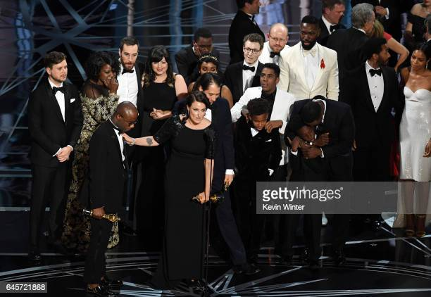 Cast and crew of 'Moonlight' accept the Best Picture award onstage during the 89th Annual Academy Awards at Hollywood Highland Center on February 26...