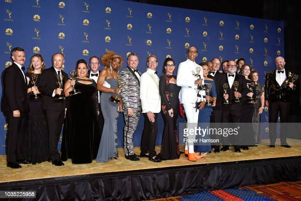 Cast and crew of Outstanding RealityCompetition Program winner RuPaul's Drag Race pose in the press room during the 70th Emmy Awards at Microsoft...