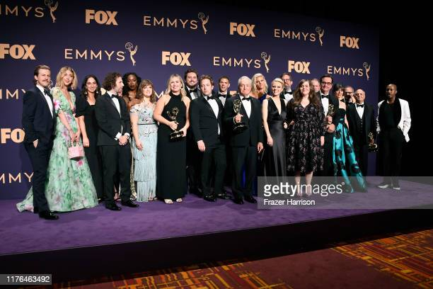 Cast and crew of 'Saturday Night Live' pose with awards for Outstanding Variety Sketch Series in the press room during the 71st Emmy Awards at...
