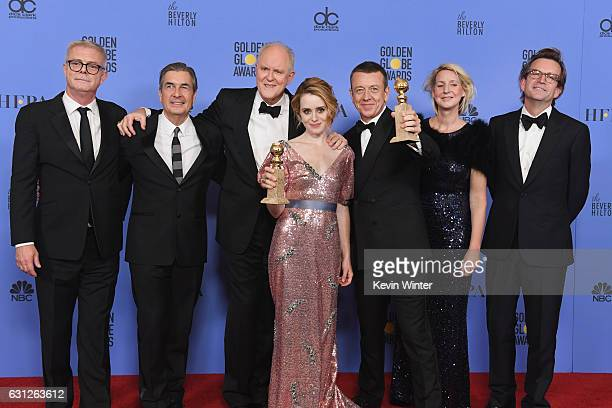 Cast and crew of 'The Crown' winner of Best Series Drama pose in the press room during the 74th Annual Golden Globe Awards at The Beverly Hilton...