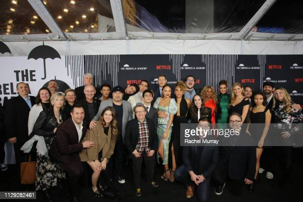 Cast and Crew of The Umbrella Academy pose for group photo at The Umbrella Academy Premiere at Cinerama Dome on February 12 2019 in Hollywood...